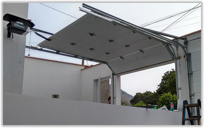 Puertas seccionales lopez sistemas - Puertas para naves industriales ...